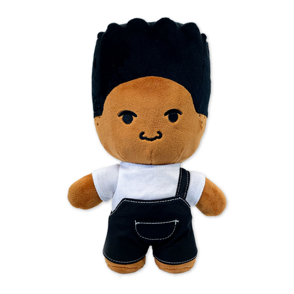 light brown dre plush doll with high top hair in white shirt with black overalls with white stitching