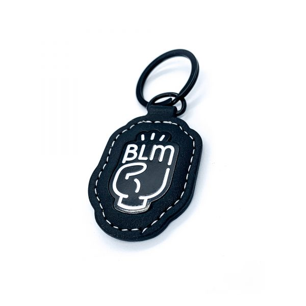 BLM fist keychain charm front with white stitching all in black and white