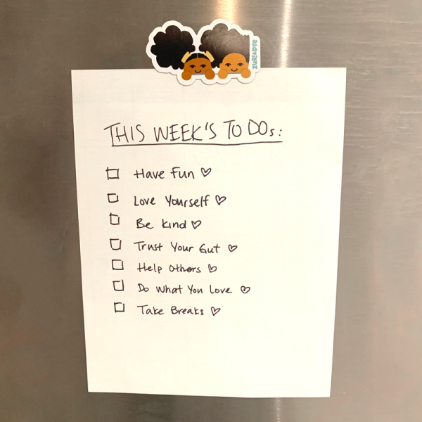 zuri & dre magnet on stainless steel fridge with list of inspirational to-do's